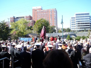 Crowd, including officers from Queen Mary 2, gathered for unveiling of statue of Samuel Cunard, Halifax waterfront, October 7, 2006