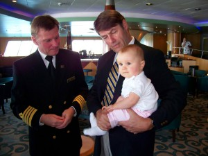 A new generation of 'Cunarder' – Cunard Steamship Society ChairmanJohn G. Langley, Q.C. with granddaughter Elle Adison Langley and Captain McNaught onboard QE2 in Halifax, Nova Scotia September 21, 2008