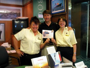 Cunard Steamship Society Chairman John G. Langley, Q.C. with QE2 librarians Carmel Rogers (L) and Jayne Downey (R) onboard QE2