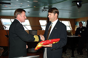 QE2 Captain Ian McNaught presents John G. Langley, Q.C., Chairmanof Cunard Steamship Society with ship's paying off pennant forHalifax, Canadian homeport for Cunard Line and birthplace ofcompany founder Samuel Cunard – onboard QE2 in Halifax,September 21, 2008