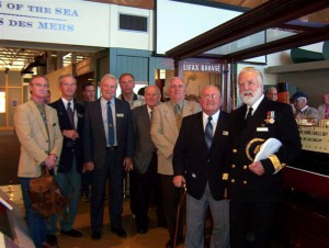 Commodore Warwick with John Green and other members of the Maritime Ship Modelers' Guild instrumental in refurbishing model of 'Franconia' at MMA