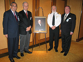 Hon. Alan Abraham, John Jay and Robert Stapells, three members of the Sir Samuel Cunard Memorial Committee meeting with Honorary Chairman Commodore Warwick aboard QM2 in Halifax October 3, 2005