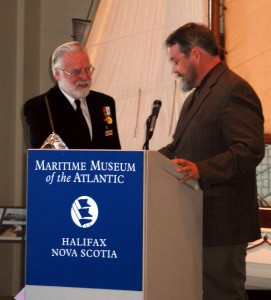 Presentation of Nova Scotia crystal to Commodore Warwick as first recipient of 'Admiralty Circle Award' from Maritime Museum of the Atlantic.